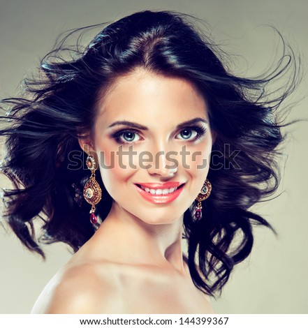 Beautiful model with flying hair - stock photo