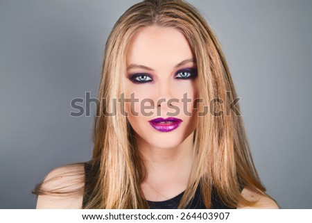 Beautiful Model With Long Flowing Hair and Dark Makeup - stock photo
