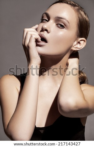 Beautiful model with natural make-up, soft focus - stock photo
