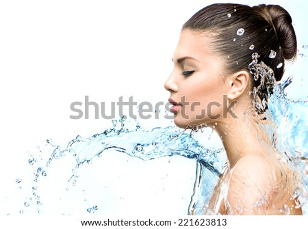 Beautiful Model Woman with splashes of water in her hands. Beautiful Smiling girl under splash of water with fresh skin on white background. Skin care, Cleansing and moisturizing concept. Beauty face  - stock photo