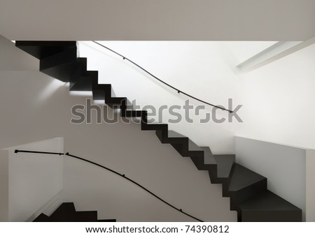 beautiful modern apartment, black stairs view - stock photo