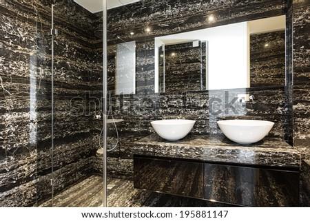 beautiful modern bathroom, marble wall - stock photo