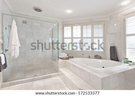 beautiful modern bathroom with marble tiles in australian mansion - stock photo
