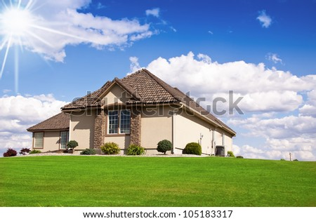 Beautiful modern design house home with blue sky - stock photo