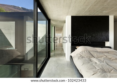 beautiful modern house in cement, interior, bedroom - stock photo