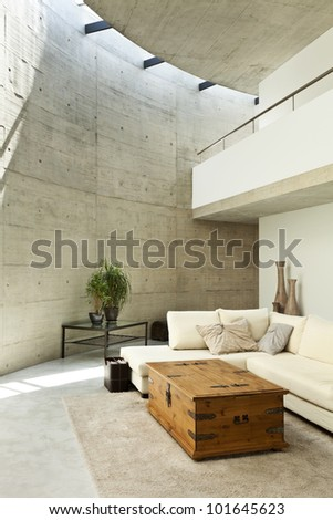beautiful modern house in cement, interior, living room - stock photo