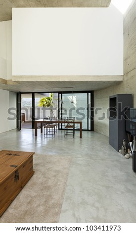 beautiful modern house in cement, interior, wide living room - stock photo