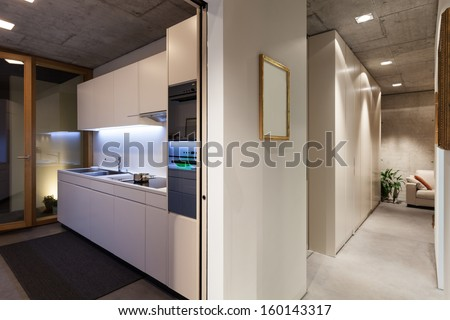 beautiful modern house in cement, interiors, view from corridor - stock photo
