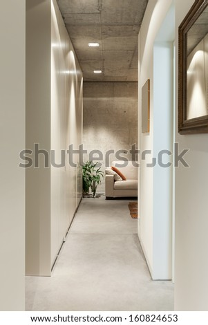 beautiful modern house in cement, interiors, view from the corridor - stock photo