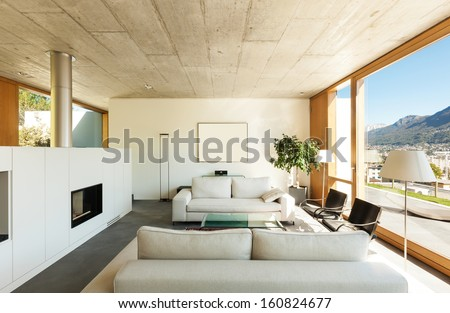 beautiful modern house in cement, interiors, view from the living room - stock photo