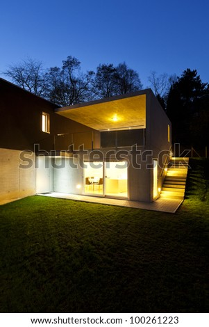 beautiful modern house, outdoor by night - stock photo