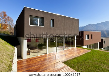 beautiful modern house with garden, outdoor - stock photo