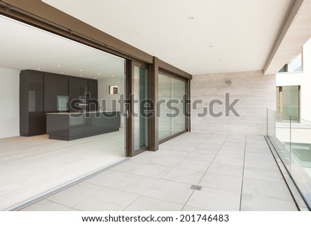 beautiful modern kitchen, view from the balcony - stock photo