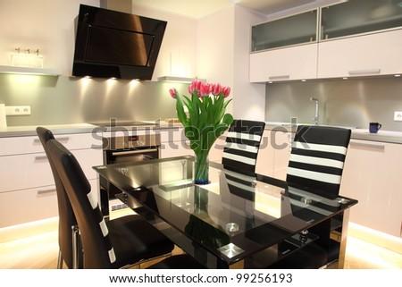 Beautiful modern kitchen with modern lighting, interior - stock photo