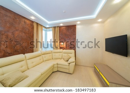 Beautiful modern living room with sofa and TV - stock photo
