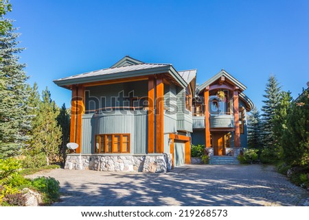Beautiful modern log house in the mountains in Canada - stock photo