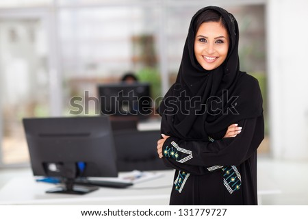 beautiful modern Muslim businesswoman portrait in office - stock photo