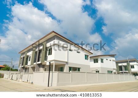 beautiful modern townhouses against blue sky Bangkok Thailand - stock photo