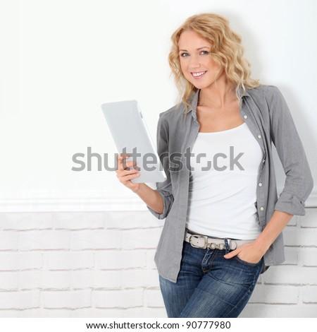 Beautiful modern woman using digital tablet - stock photo