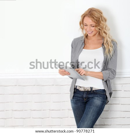 Beautiful modern woman using digital tablet - stock photo