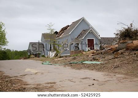 Beautiful modern wooden church after tornado damage - stock photo