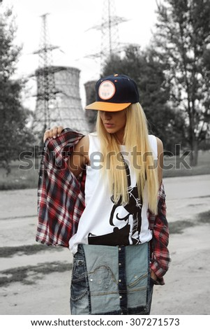 Beautiful modern young woman in a trendy clothes. Youth style. Fashion shot. - stock photo