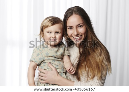 Beautiful mother and daughter portrait - stock photo