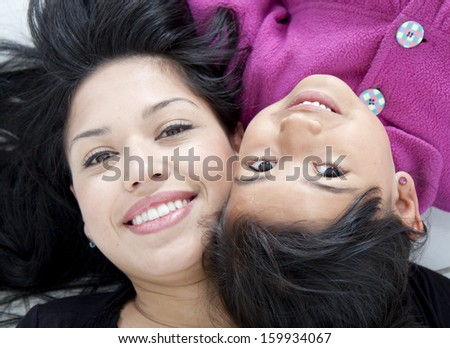 Beautiful mother and daugther over white - stock photo