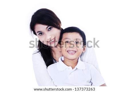 Beautiful mother and her son on white background - stock photo