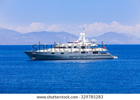 Beautiful motorized yacht swimming in the Ionian sea from the Mediterranean sea. - stock photo
