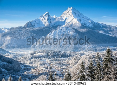 Beautiful mountain landscape in the Bavarian Alps with village of Berchtesgaden and Watzmann massif in the background at sunrise, Nationalpark Berchtesgadener Land, Bavaria, Germany - stock photo