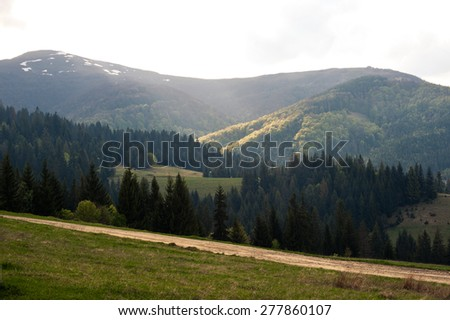 beautiful mountain landscape in warm sunset light - stock photo