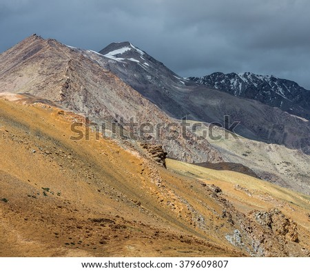 Beautiful mountain landscape near the Tso Moriri lake and Karzok village in Rupshu valley against the background of cloudly sky - Tibet, Ladakh, Himalayas, Jammu and Kashmir, Northern India - stock photo