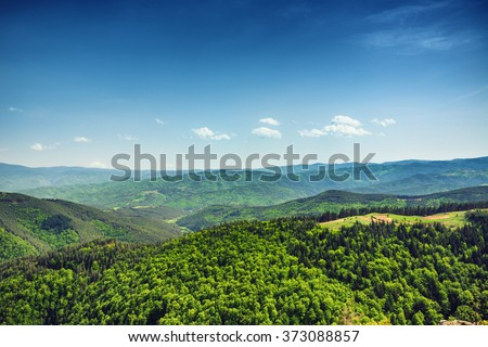 Beautiful mountain landscape, with mountain peaks covered with forest and a cloudy sky. Bulgarian mountains, Europe - stock photo