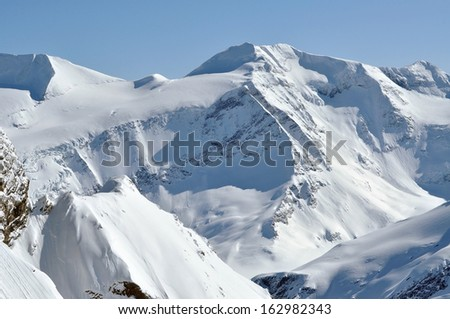 Beautiful mountain massif covered in snow at winter  - stock photo