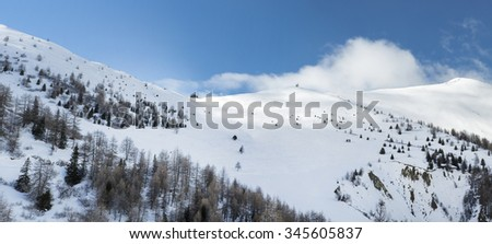 Beautiful mountain peak and an alpine house. Ski slopes and tracks of austrian Alps, view at the Grossglockner mountain in Austria. - stock photo