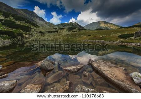 Beautiful mountain scenery, rocks and alpine lake - stock photo
