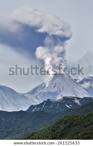 Beautiful mountain (volcanic) landscape of Kamchatka: eruption active Zhupanovsky Volcano on Kamchatka Peninsula (Russia, Far East). - stock photo