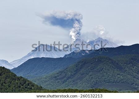Beautiful mountain (volcanic) landscape of Kamchatka Peninsula: eruption active Zhupanovsky Volcano on Kamchatka (Russia, Far East). - stock photo