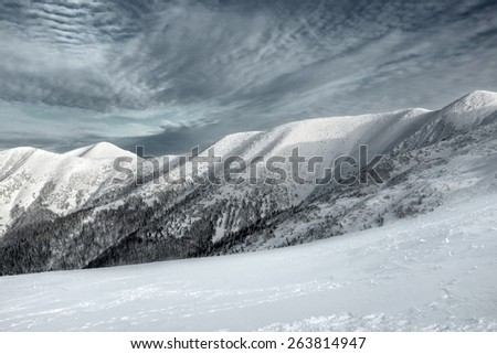 Beautiful mountains view at winter under sky. - stock photo