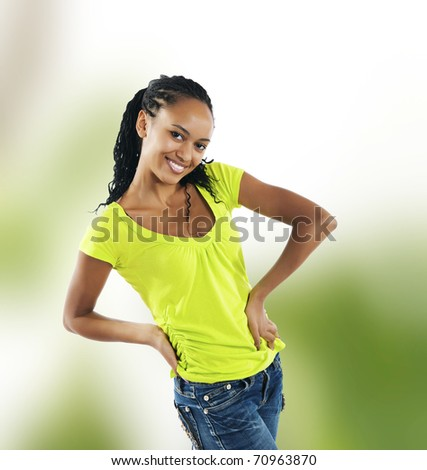 beautiful mulatto girl on green background - stock photo