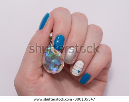 beautiful multi colored nails on a white background - stock photo