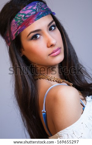 Beautiful multicultural young woman studio portrait. - stock photo