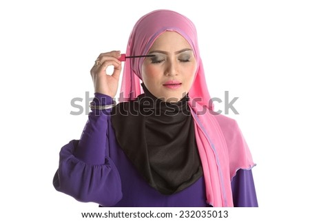 Beautiful Muslim female eyes with bright make-up and brush. Makeup. Cosmetic. Base for Perfect Make-up.Applying Make-up - stock photo