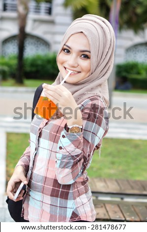 beautiful muslim woman drink a water - stock photo