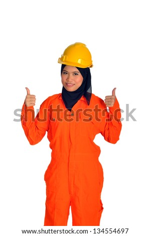 Beautiful muslim woman with personal protective equipment show thumbs up - stock photo