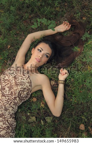 beautiful mysterious woman in forest - stock photo