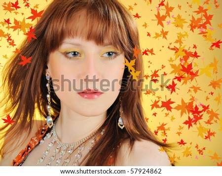 Beautiful mystic autumn woman with golden make-up. yellow leaf fall  background - stock photo