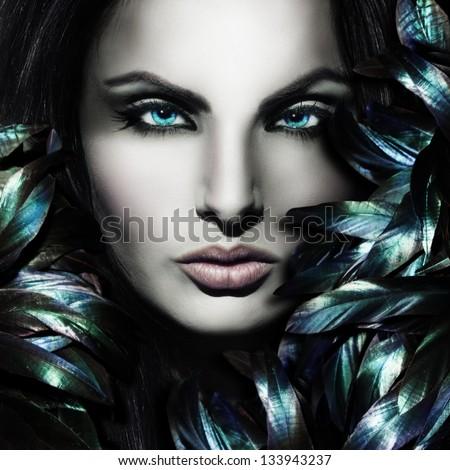 Beautiful mystic woman face - stock photo