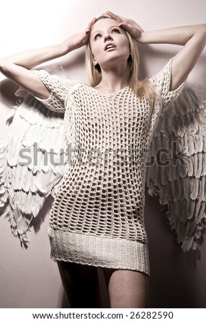 beautiful naked angel with white furs over white background - stock photo